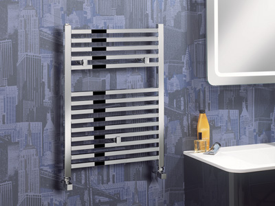 Bathroom heater rack mounted on wall decorated with blue city skyline wallpaper.